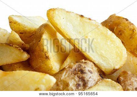 Detail Of Fried American Potato Wedges On White.