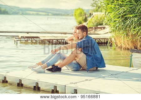 Couple in love on the pier sit