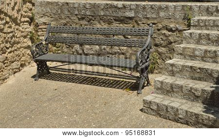 Iron Bench On Stone Wall