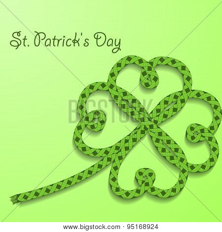 Background With Inscription St. Patricks Day. Clover With Four Petals Of Green Folded Rope.