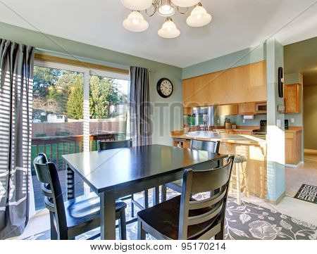 Nice Dinning Room With Carpet And Windows.