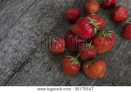 Strawberries Lying On A Crude Wooden Surface