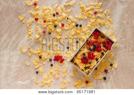 Corn Flakes With Red Currants And Blueberries For Breakfast