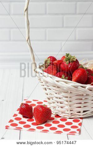Ripe strawberry in white basket