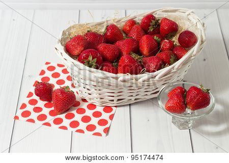 Ripe red strawberry in white basket