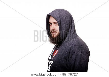 Adult man in the hood sits thinking. Isolated on white backgroun