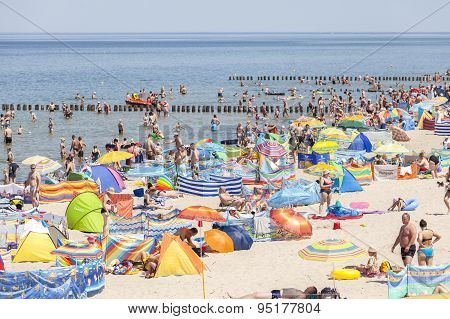 Crowded Beach In Dziwnowek, One Of The Most Visited Summer Spots.