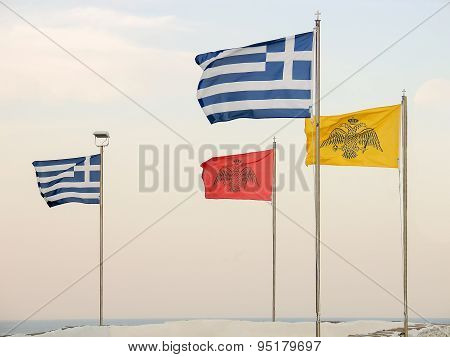 Greek flags against the sky.