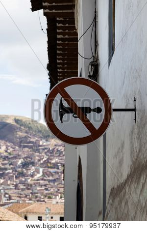 No Car Horns Sign On Building Cusco Peru