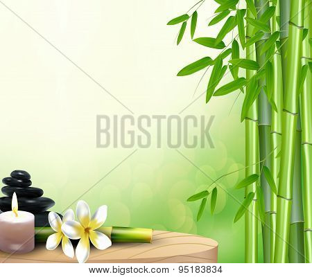Bamboo, stone, flowers and wax background on the table