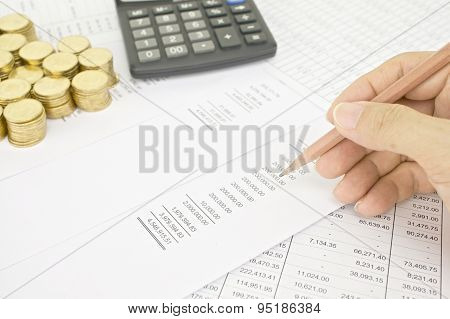Man Holding Pencil To Audit  Finance Account