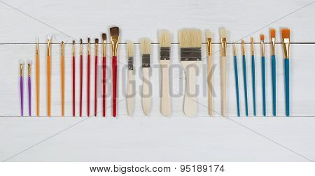 Organized New Paintbrushes On White Wooden Boards