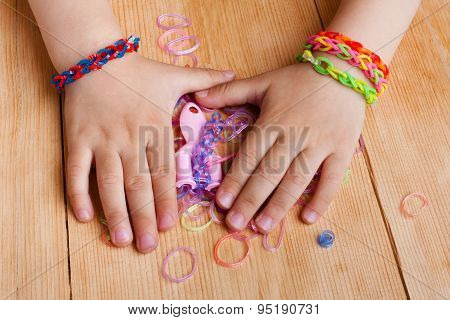 Child Hands With Rubber Bands