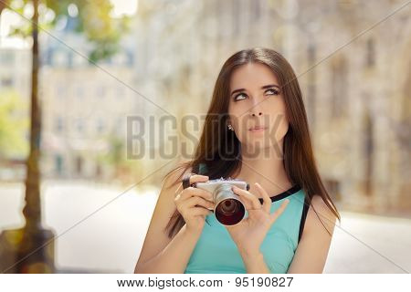 Undecided Girl with Compact Digital Camera
