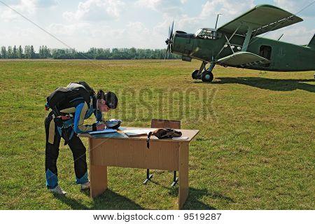 The Parachutist Writes On A Table
