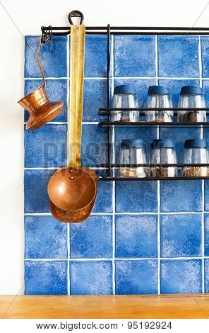 Metal Shelf With Different Seasonings, Spices In Glass Bottles.