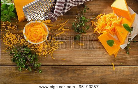 Cheddar Cheese On  Rustic Wooden Background.