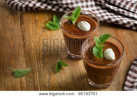 Homemade Chocolate Mousse In Glasses On   A Wooden Table.