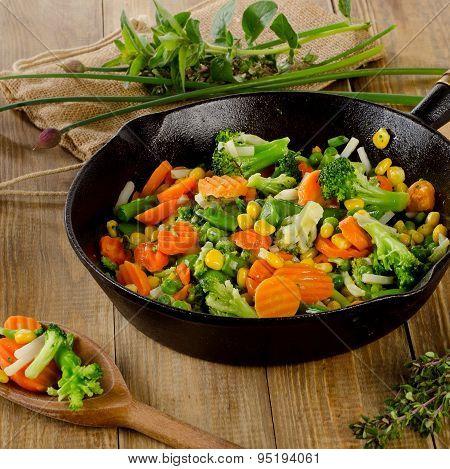 Stir Fried Vegetables In  Iron Skillet .