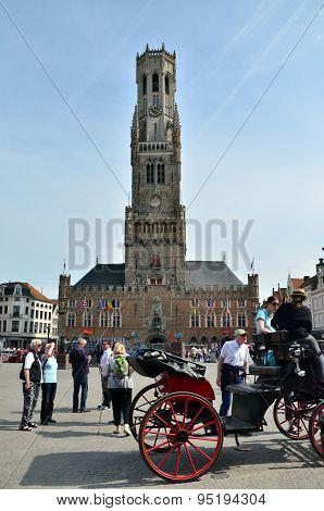 Bruges, Belgium - May 11, 2015: Tourist Visit Belfry Of Bruges On Grote Markt Square