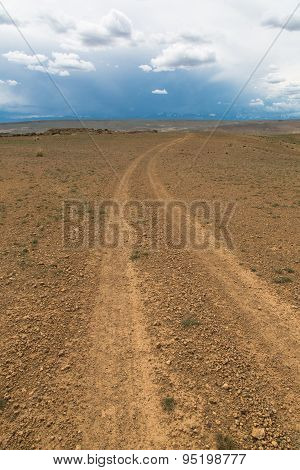 Dirt Road Leaving To The Horizon
