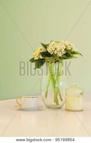 Vase Of Flowers And Teacup In Soft Green Pastel Hues