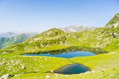 pic of italian alps  - High altitude blue lake in idyllic uncontaminated environment once covered by glaciers - JPG