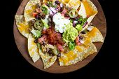 image of nachos  - Homemade Nachos with tortilla chips cheese and guacamole - JPG