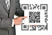image of qr codes  - Businessman holding picture with QR - JPG