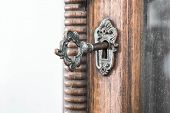 image of keyhole  - Vintage keyhole with key on vintage wooden cabinet with white background - JPG