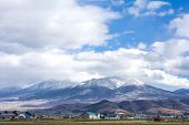 picture of snow capped mountains  - Snow capped mountain range under sky in late autumn of Hokkaido - JPG