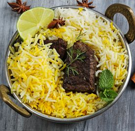 picture of raita  - Beef biryani in a kadai with basmati ruce and raita - JPG