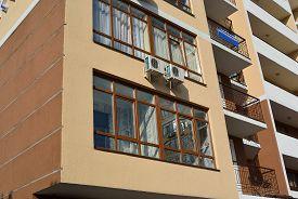 stock photo of tenement  - the glazing loggia in big tenement house - JPG