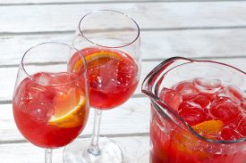 image of cold drink  - Red raspberry cold drink in glass jug - JPG