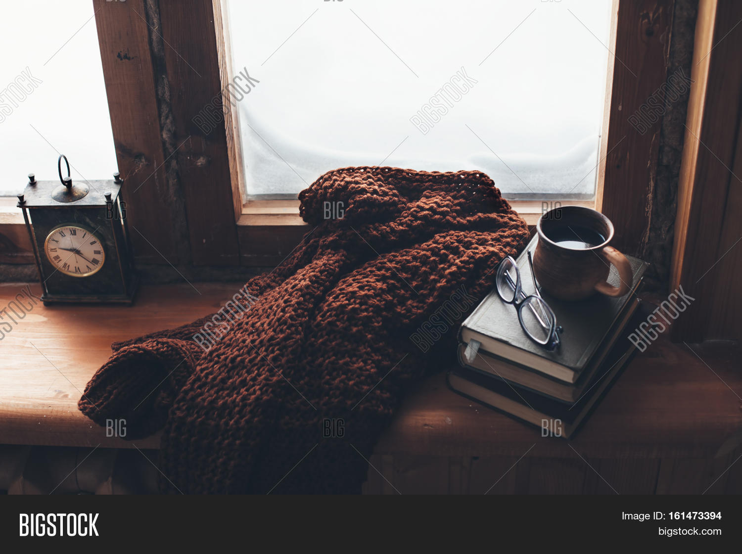 Warm and comfy winter concept book cup of tea and for Windows for cold climates