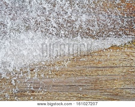 Texture of wooden surface. Frozen trees covered with ice snow and hoar frost in winter