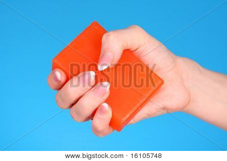 Soap in hand  on blue background