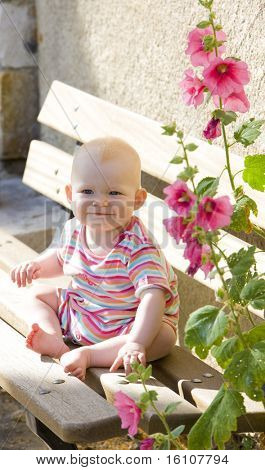 baby girl sitting on bench, Rougon, Provence, France