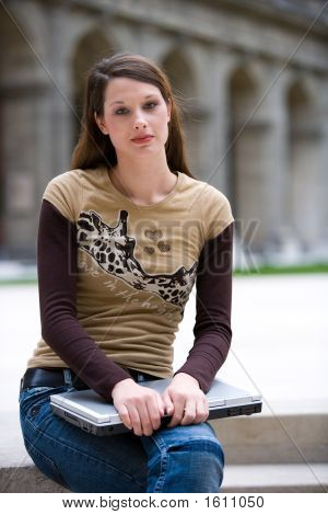 Sitting With Notebook Outdoor