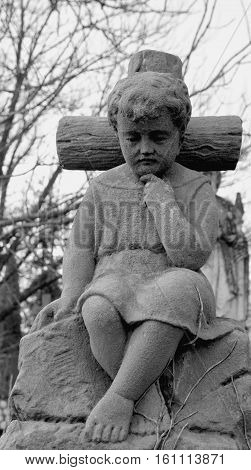 The statue of the boy on the cross.