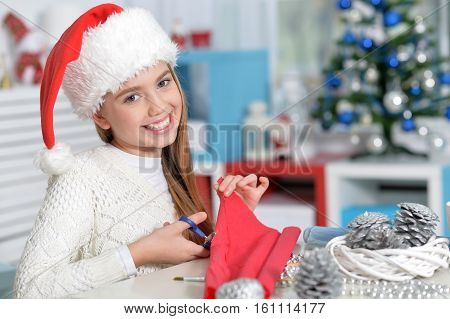 Portrait of happy teen girl preparing for Christmas at home