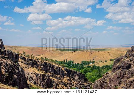 Turbat Canyon And Grasslands Behind, Kazakhstan