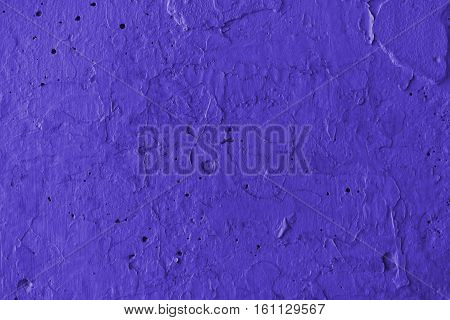 Plaster, plaster purple color on a concrete wall. Stucco purple  wall background or texture. Plaster, plaster texture, plaster background. Purple wall, purple background. Color plaster.