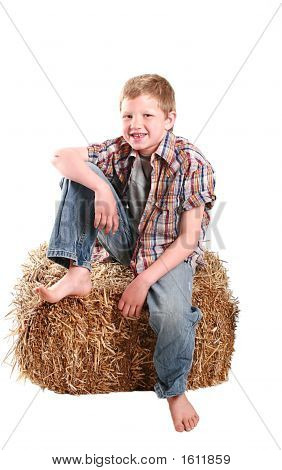 Farmer Kid Sitting On Hay