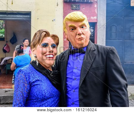 Cuidad Vieja, Guatemala - December 7 2016: Participants wearing Donald Trump & Hillary Clinton masks in Virgin of the Immaculate Conception street parade