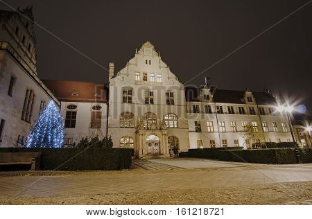 Facade of the building assembly hall university and christmas tree in Poznan