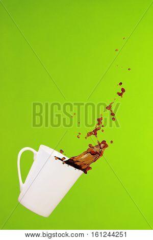 Coffee Concept. Minimal Art. Solid Background. Coffee Splashes. Levitating Mug