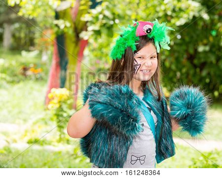 Adorable little child girl with akvagrim on happy birthday. Summer green nature background. Use it for baby parenting or love concept