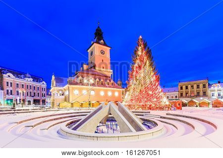 Brasov, Romania. Christmas Market in the old town at twilight.