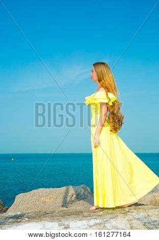 Portrait of the young beautiful woman with long hair and outdoor